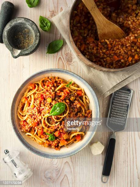 healthy vegan spaghetti bolognese - elevated view stock pictures, royalty-free photos & images
