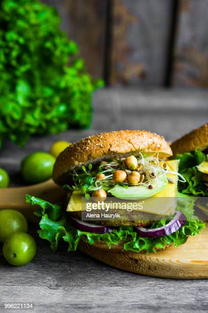 Healthy vegetarian burger on wooden background