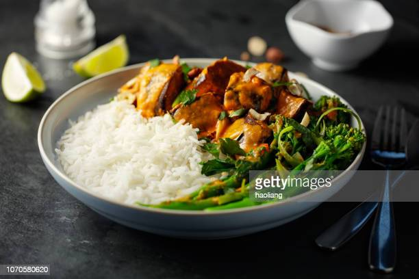 healthy vegetarian thai red curry with rice - curry stock pictures, royalty-free photos & images