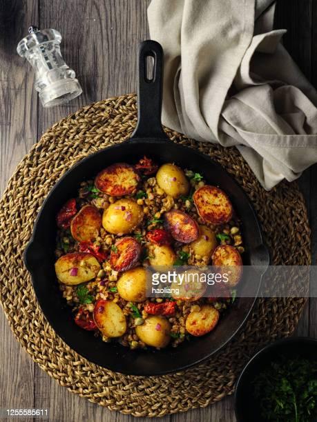 healthy warm vegan potato salad - salad stock pictures, royalty-free photos & images