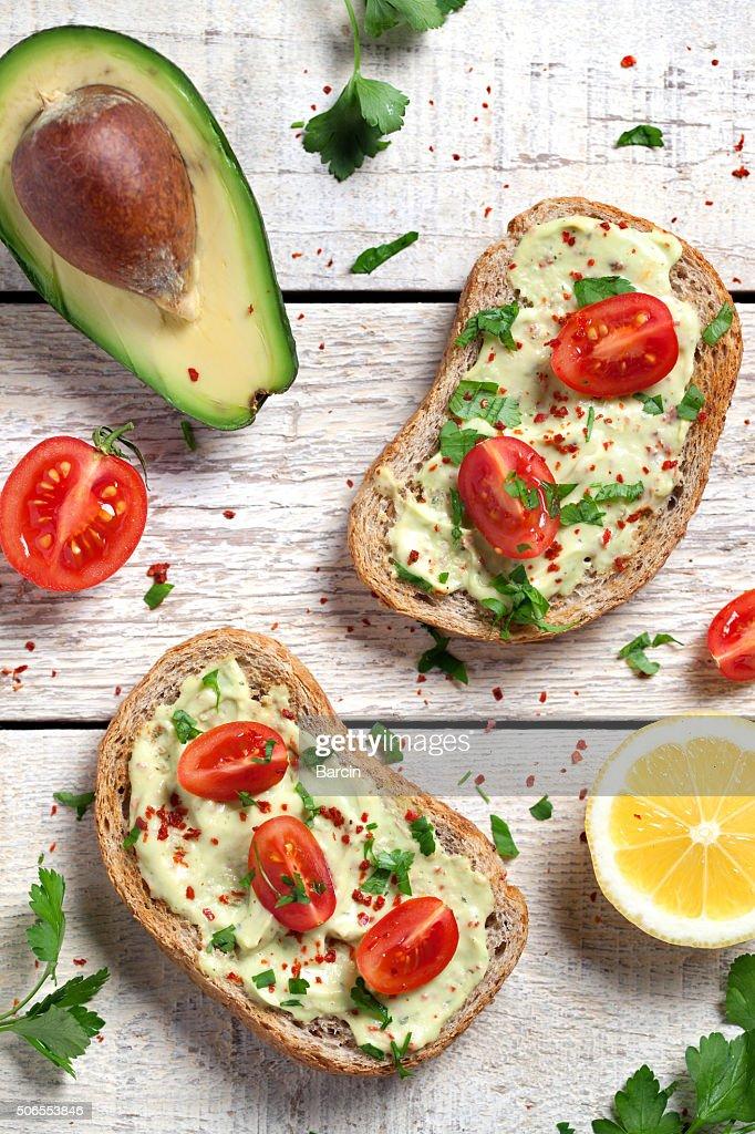 Healthy whole grain bread with avocado : Stock Photo