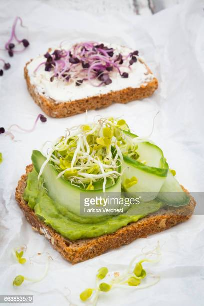 healthy whole grain bread with different toppings - larissa veronesi stock pictures, royalty-free photos & images