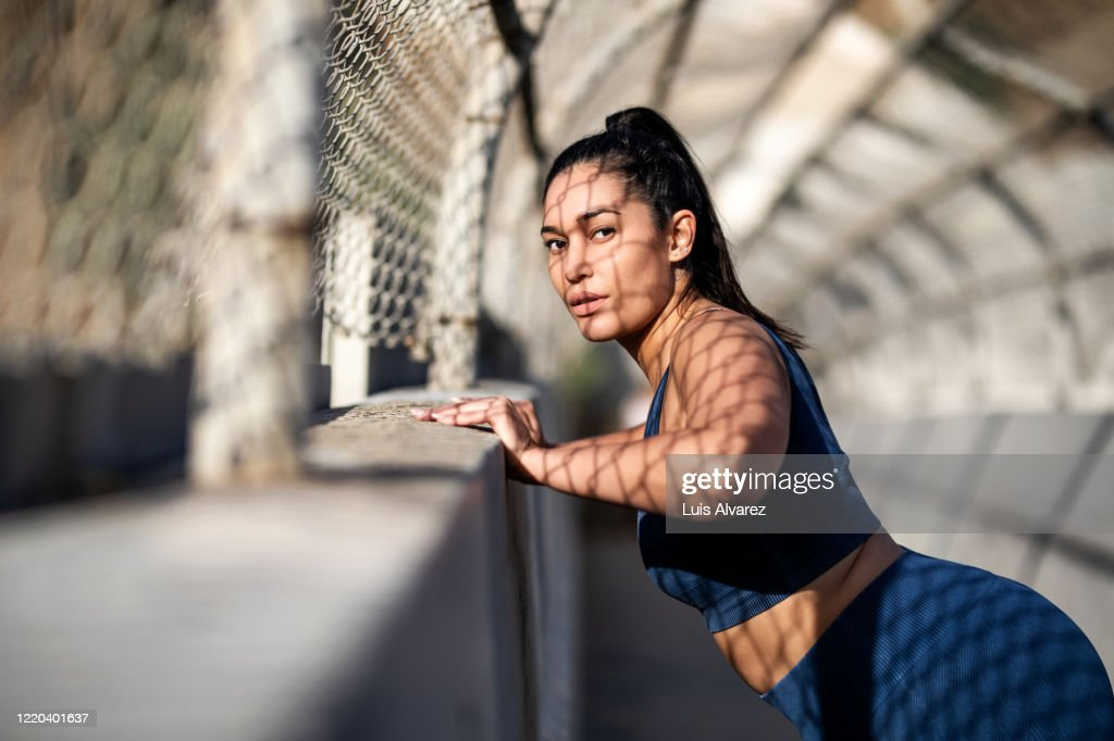 Healthy woman doing some stretching workout outdoors : Stockfoto