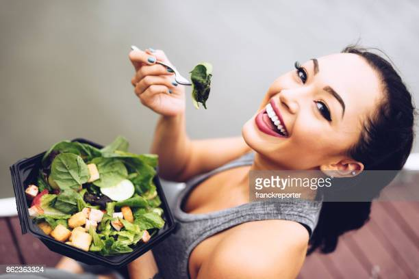 healthy woman eating the salad - salad stock pictures, royalty-free photos & images