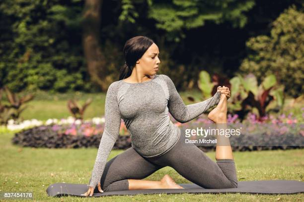 Healthy woman practicing yoga in the park