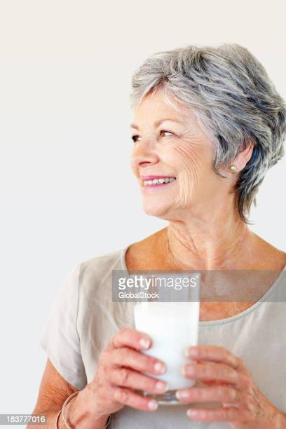 Healthy woman with a glass of milk