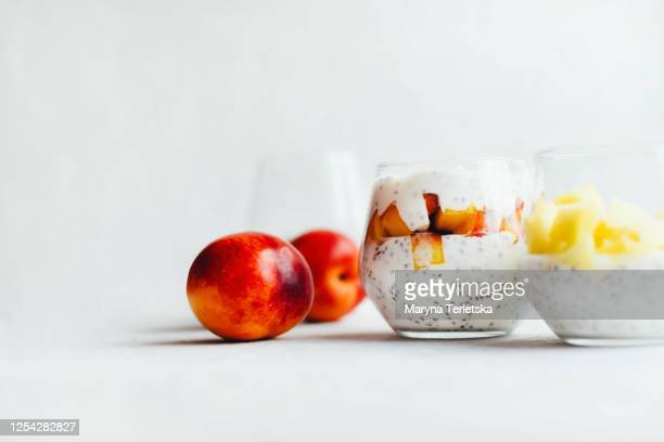 healthy yogurts with chia seeds and fruits. - mousse dessert stock pictures, royalty-free photos & images