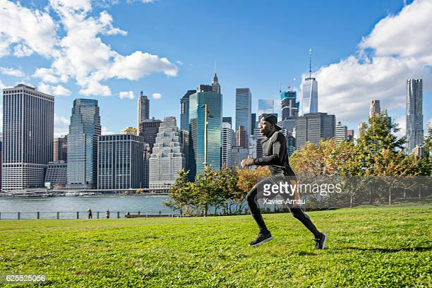 Healthy young african man running in park
