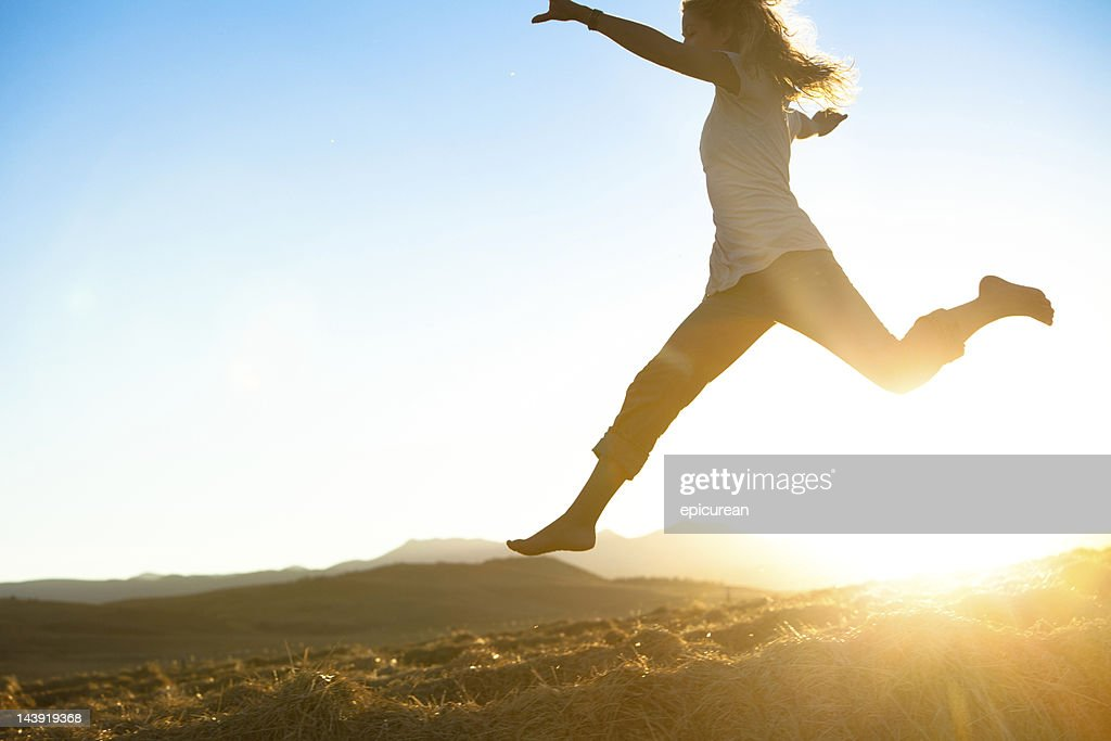 Healthy young beautiful woman running barefoot : Stock Photo