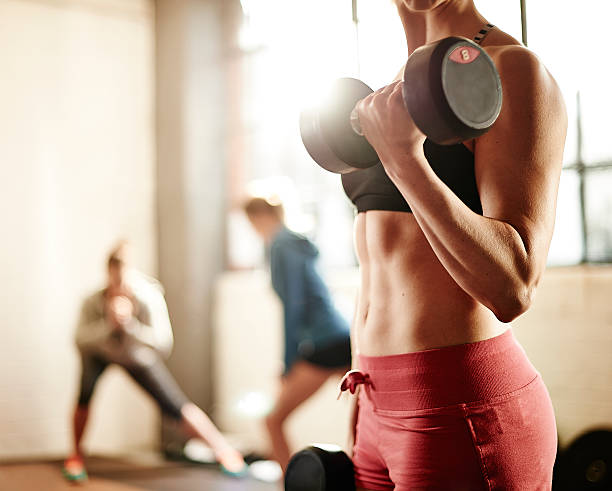 healthy young female weight training in gym picture