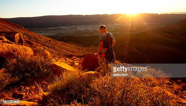 Healthy young man hiking at sunset in Utah near Moab