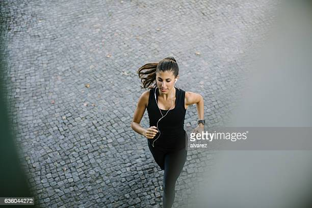 Healthy young woman running in the city