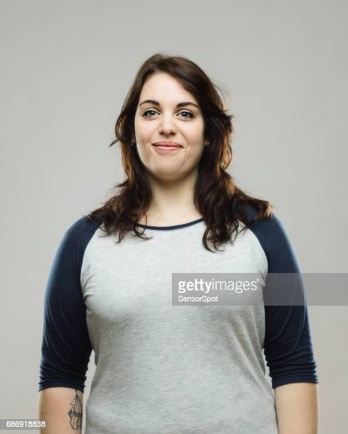 healthy young woman smiling on gray background - fat girls stock photos and pictures