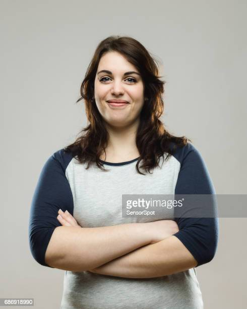Healthy young woman standing with her arms crossed