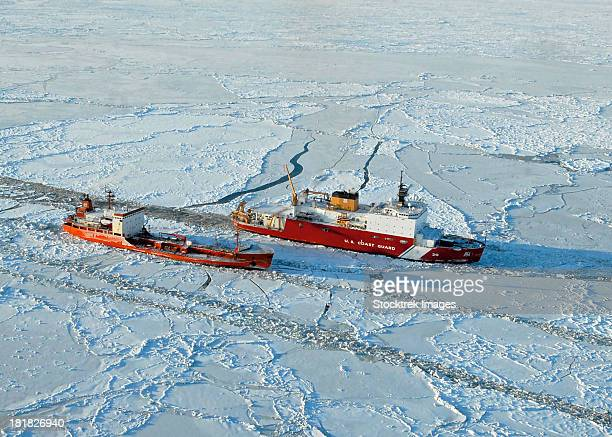 USCG Healy breaks ice around a Russian-flagged tanker south of Nome, Alaska.