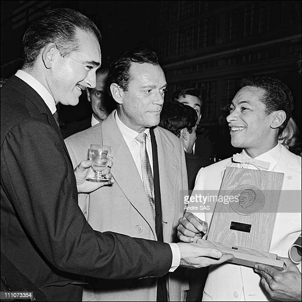 Heanri Salvador, Eddie Barclay and Eddie Constantine in France on November 14, 1958.