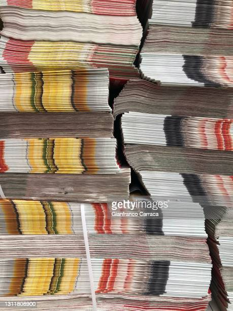 heap of advertising flyers ready to be distributed to the mailboxes of the houses - stack stock pictures, royalty-free photos & images