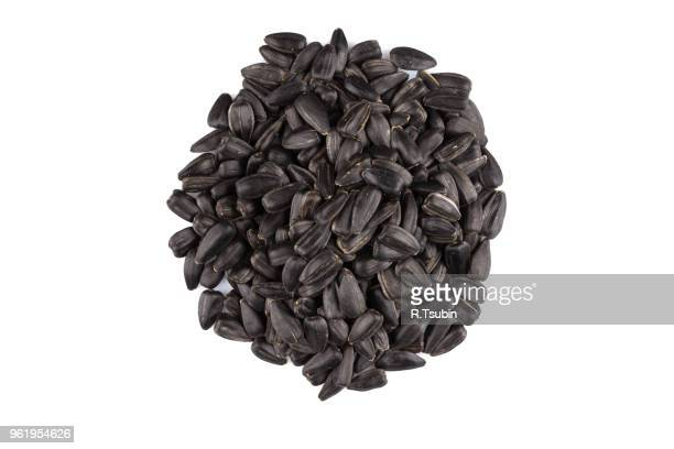 heap of black sunflower seeds isolated on a white background - black seed oil stock pictures, royalty-free photos & images