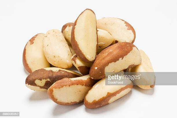 a heap of brazil nuts - brazil nut stock photos and pictures