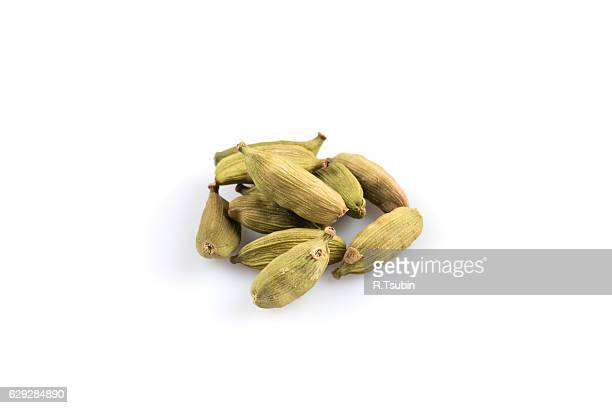 heap of cardamom pods - cardamom stock photos and pictures
