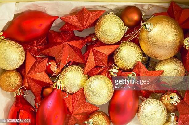 Heap of Christmas ornaments in tissue paper