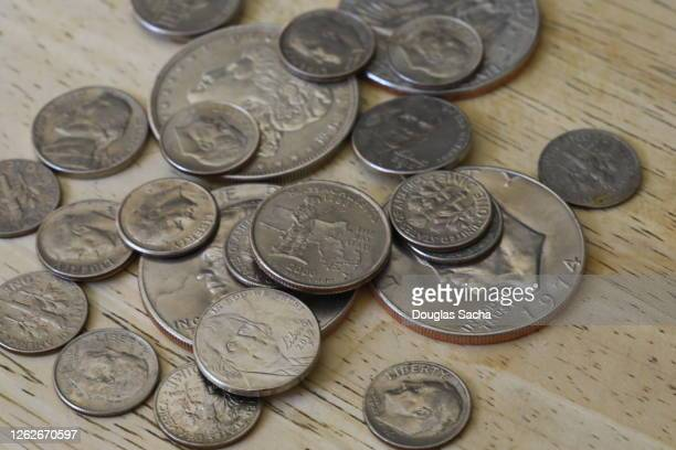 heap of coins - dime stock pictures, royalty-free photos & images