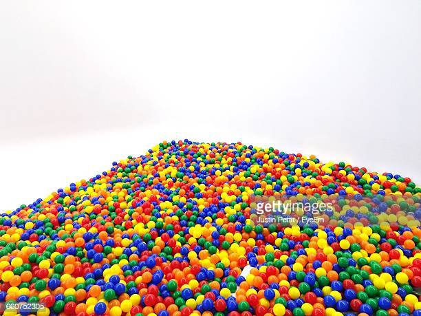 Heap Of Colorful Ball Pool Against White Background