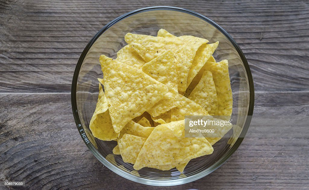 Heap of corn chips in the glass bowl : Stockfoto
