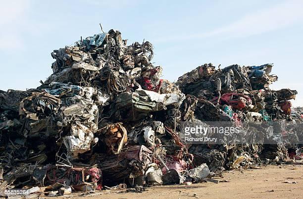 Heap of crushed cars in scrap metal yard