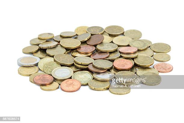Heap of different Euro coins isolated on white background.