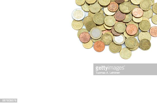 Heap of different Euro coins isolated on white background, viewed from above. Copy space.