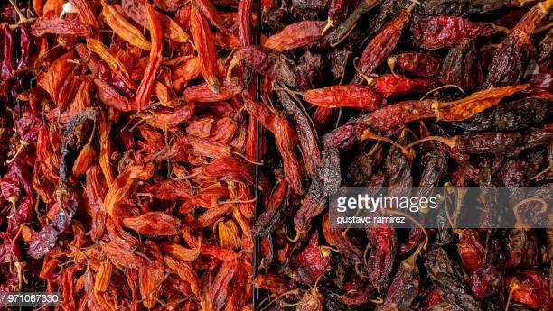 heap of dried red chili pepper for sale on market - trachurus stock pictures, royalty-free photos & images