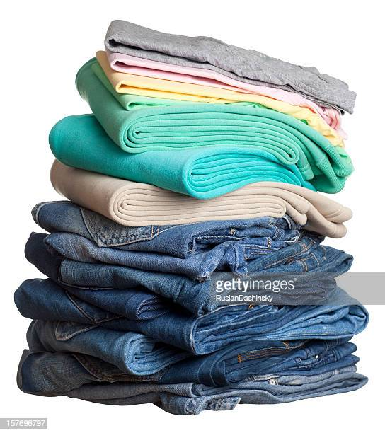 heap of folded clothes. - denim dress stock photos and pictures