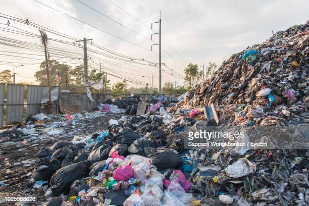 heap of garbage against sky - junkyard stock photos and pictures