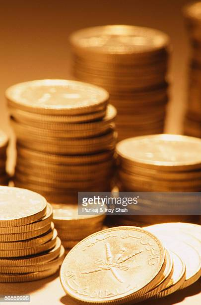 Heap of gold coins are seen at close up.