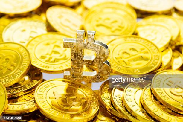 heap of golden bitcoins background - bitcoin stock pictures, royalty-free photos & images