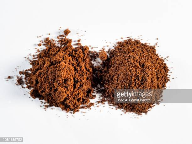 heap of ground coffee, arabica and robusta. - café moulu photos et images de collection