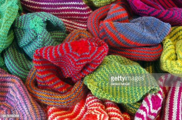 heap of handmade woollen baby beanies - multi colored hat stock pictures, royalty-free photos & images