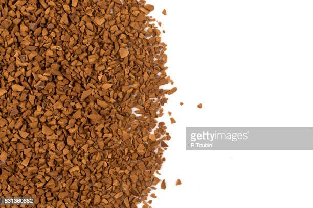 Heap of instant coffee on white