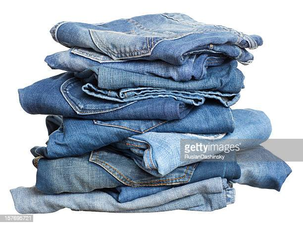 Heap of jeans before laundry.