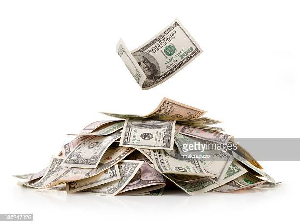 heap of money. dollar bills. - stack stock photos and pictures