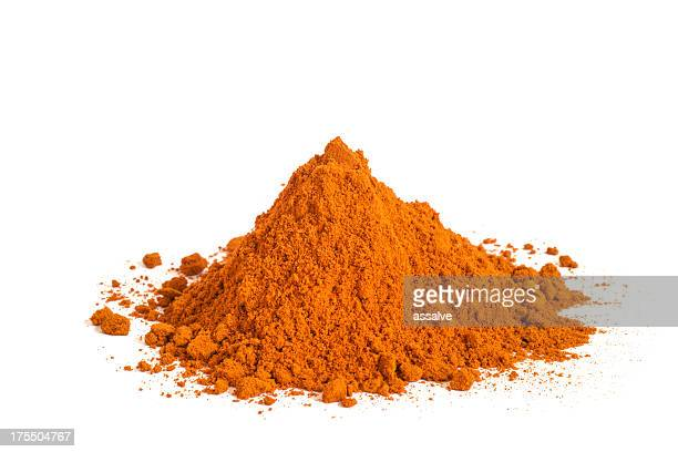 heap of paprika or chii powder on white background - paprika stock pictures, royalty-free photos & images