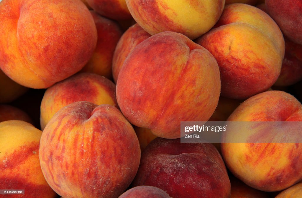 A heap of ripe Peaches (Prunus persica) close-up : Stock Photo