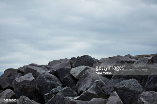 heap of rocks against sky - rock stock pictures, royalty-free photos & images