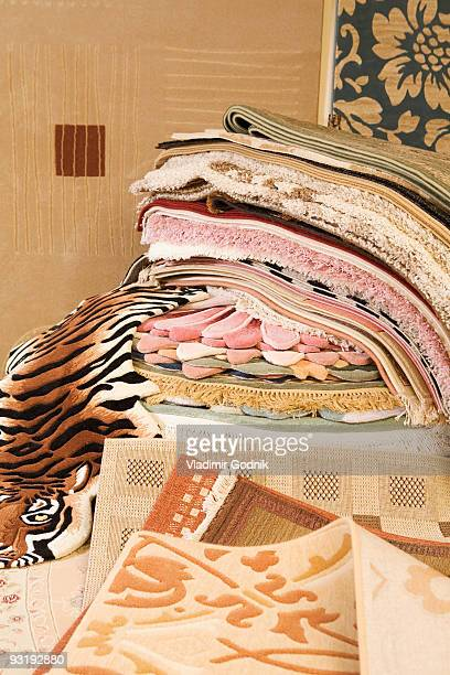 A heap of rugs and carpets