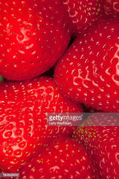 A heap of strawberries, close-up, full frame