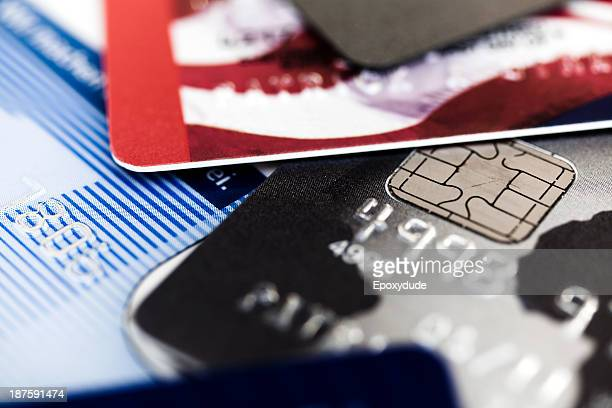 A heap of various credit cards, extreme close up