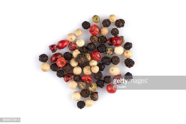 heap of various pepper peppercorns seeds mix on white - pepper stock pictures, royalty-free photos & images