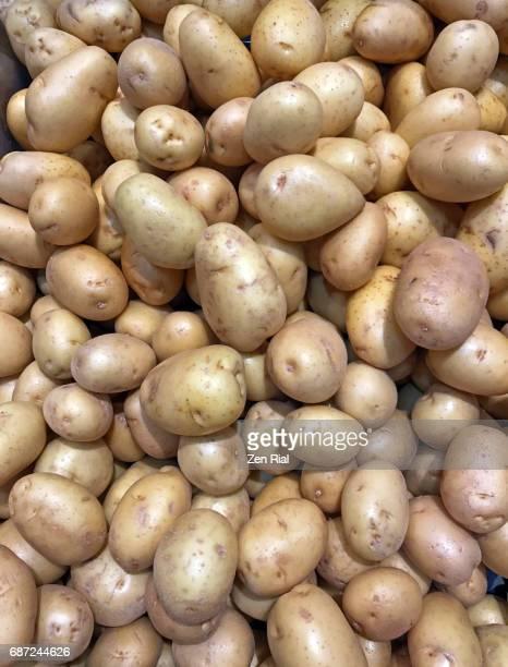 Heap of White potatoes (Solanum tuberosum) in a market