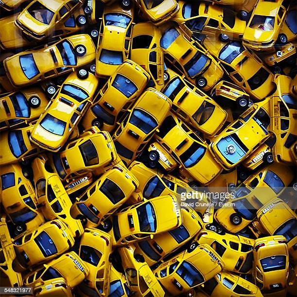 heap of yellow taxi cabs - large group of objects stock pictures, royalty-free photos & images